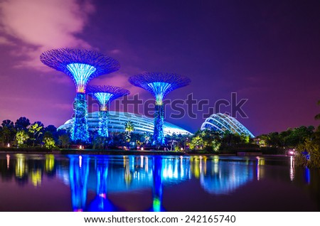 SINGAPORE - August 2: Supertree Grove at Gardens by the Bay on August 2, 2014 in Singapore. Spanning 101 hectares of reclaimed land in central Singapore, adjacent to the Marina Reservoir. - stock photo
