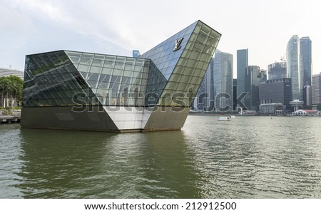 SINGAPORE - AUGUST 4, The futuristic building of Louis Vuitton extends out into Marina Bay on August 4, 2014 in Singapore - stock photo