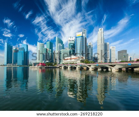 Singapore business district skyscrapers skyline and Marina Bay in daytime - stock photo