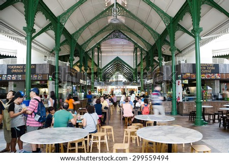 SINGAPORE - CIRCA FEBRUARY, 2015: Lau Pa Sat Festival Market was formerly known as Telok Ayer Market - now it is a popular catering in Singapore. Is a national historic landmark of Singapore. - stock photo