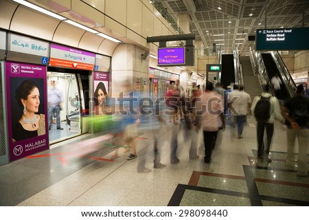 SINGAPORE - CIRCA FEBRUARY, 2015: Passengers at the MRT station in Singapore. MRT is a rapid transit system forming the major component of the railway system in Singapore. - stock photo