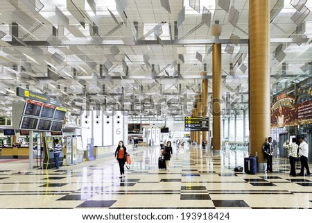 SINGAPORE - CIRCA MAY 2014 : Changi International Airport in Singapore. Changi Airport serves more than 100 airlines operating 6,100 weekly flights connecting Singapore to over 220 cities - stock photo