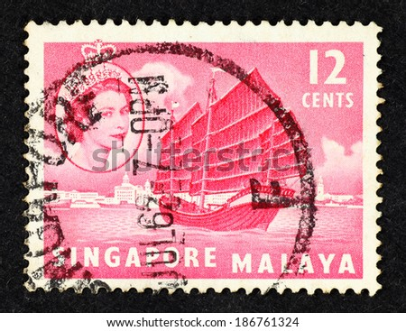 SINGAPORE - CIRCA 1961: Red color postage stamp printed in Singapore with image of a Chinese junk ship.  - stock photo