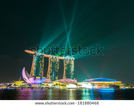 Singapore city at night with laser show. - stock photo