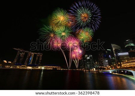 Singapore city building firework at Marina bay for New Year  - stock photo