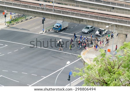 SINGAPORE CITY - 04 JULY 2015: Overhead View Of Commuters Crossing The Street, Singapore City.   - stock photo