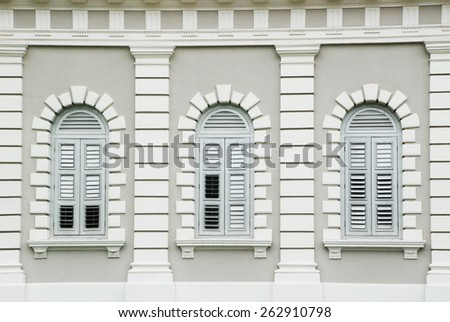Singapore City, Singapore - December 14, 2008: Window of The National Museum of Singapore is a oldest museum focusing on exhibits related to the history of Singapore. - stock photo