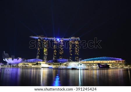Singapore City, Singapore - July, 12 2014 : Laser show of Singapore Marina Bay Sand - stock photo