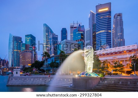 Singapore City, Singapore - July 18, 2015: Marina Bay skyline and Merlion at twilight. The Marina Bay is a bay near Central Area in of Singapore, and lies to the east of the Downtown Core.