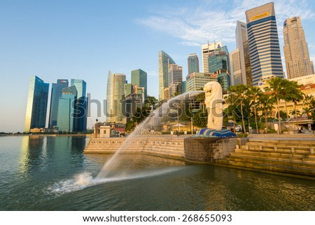 Singapore City, Singapore - June 21, 2014: View of Merilon Statue at Marina Bay in Singapore with tourists and Singapore Skyline in background.
