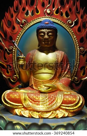 SINGAPORE CITY, SINGAPORE - NOV 13, 2013: View of of a Buddha statue at the Buddha Tooth Relic Temple and Museum. The Taoist Buddhist shrine houses a tooth relic of the historical Gautama Buddha. - stock photo