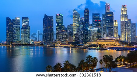 SINGAPORE CITY, SINGAPORE - 29 OCTOBER 2014: Evening view of Downtown Core Skyscrapers and Bayfront district. Singapore City state. - stock photo