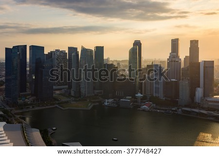 Singapore City Skyline Aerial View Cityscape Aerial View Panorama of CBD over Marina Bay under Dramatic Golden Sky Sunset in Summer