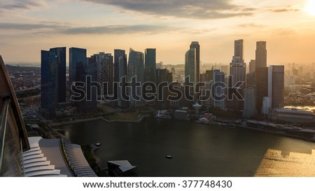 Singapore City Skyline Aerial View Cityscape Aerial View Panorama of CBD over Marina Bay under Dramatic Golden Sky Sunset in Summer - stock photo