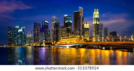 Singapore city skyline at dusk - stock photo