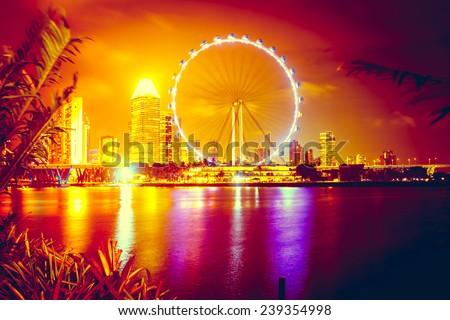 Singapore city skyline at night - stock photo