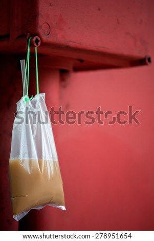 Singapore Coffee (Kopi) in a take-away bag. - stock photo