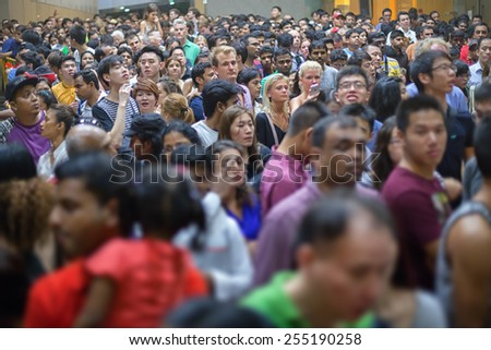 SINGAPORE - 31 DEC 2013: A huge crowd of people collected in Singapore to commemorate the arrival of the New Year. - stock photo