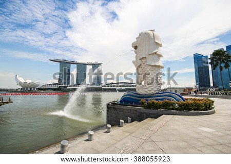 SINGAPORE-DEC 03, 2014: Merlion statue fountain in Merlion Park and Singapore city skyline on December 03, 2014. This fountain is one of most well known icons of Singapore