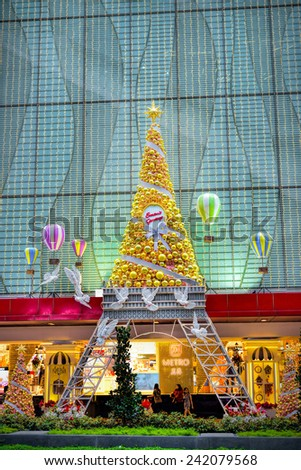 SINGAPORE -DEC 29: Night view of Christmas Decoration at Singapore Orchard Road on December 29, 2014 in Singapore. The street with colourful christmas trees, ball, stars & dressed-up shopping centres. - stock photo