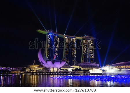 SINGAPORE - DEC 29: Night view of Marina Bay Sands Resort Hotel on Dec 29, 2012 in Singapore. It is billed as the world's most expensive standalone casino property. - stock photo