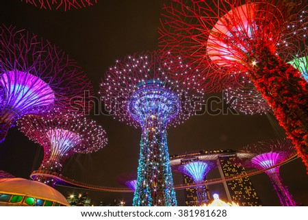 SINGAPORE - Dec 2014 Night view of Supertree at Gardens by the Bay on Dec 04, 2014 in Singapore. Spanning 101 hectares of reclaimed land in central Singapore, adjacent to Marina Reservoir. - stock photo
