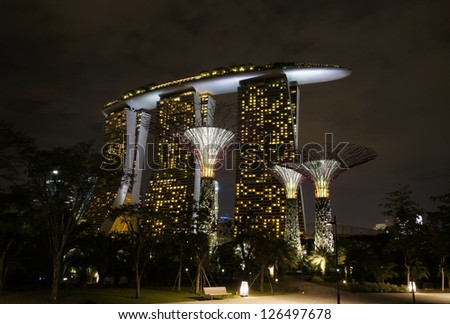 SINGAPORE - DEC 29 : Night view of The Supertree Grove on Dec 29, 2012 in Singapore. Spanning 101 hectares of reclaimed land in central Singapore. - stock photo