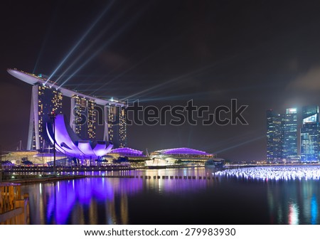 SINGAPORE - 30 DEC 2013: Singapore's skyline with spotlights lit up over Marina Bay before the annual New Year's Celebration. - stock photo