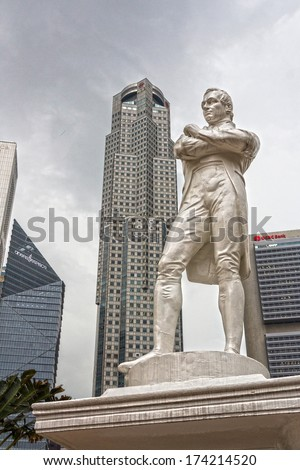 SINGAPORE - DEC 30, 2013: Sir Raffles statue with modern skyscrapers on background, Singapore  - stock photo