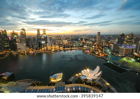SINGAPORE - December 06, 2014: Aerial view of Singapore from Marina Bay Sands Sky park at night. Marina Bay Sands is an integrated resort fronting Marina Bay in Singapore.