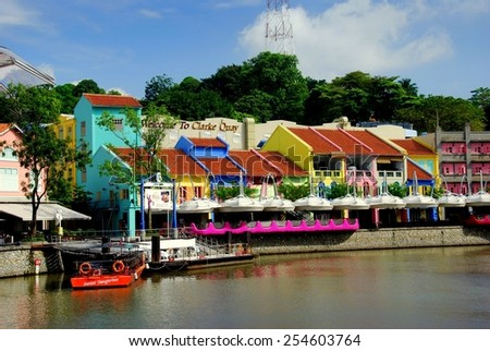 Singapore - December 13, 2008: Brightly painted pastel-colored restored buildings line Clarke Quay on the Singapore River  * - stock photo