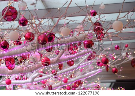 SINGAPORE - DECEMBER 15: Christmas decoration at Orchard Central on December 15, 2012 in Singapore. It wins best-dressed building for Christmas lights for second year. - stock photo