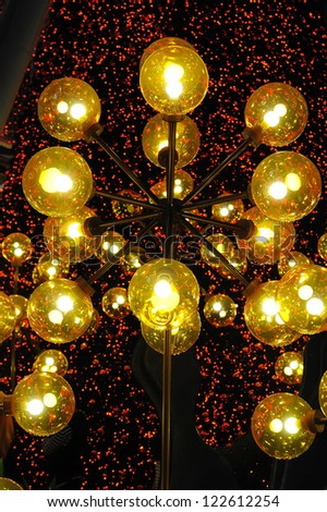 SINGAPORE - DECEMBER 15: Christmas Decoration at Singapore Orchard Road on December 15, 2012 in Singapore. The street with twinkling lights and dressed-up shopping centres. - stock photo