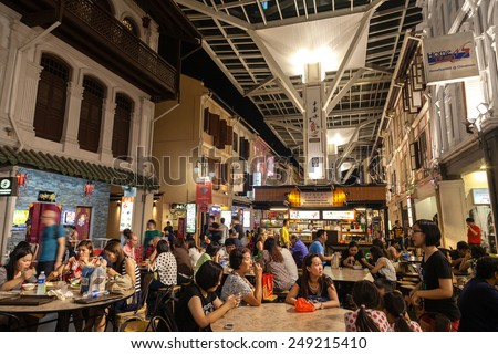 SINGAPORE - DECEMBER 12: Diners eating on Smith Street in Chinatown December 12, 2014. This outdoor Chinatown Food Street features food stalls offering authentic local Singapore dishes. - stock photo