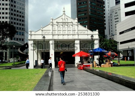 Singapore - December 12, 2007:  MRT subway entrance kiosk at Raffles Place surrounded by corporate towers and banks - stock photo