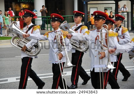SINGAPORE - DECEMBER 07: Singapore Armed Forces Band B marching during President's changing of guards parade December 07, 2008 in Singapore - stock photo