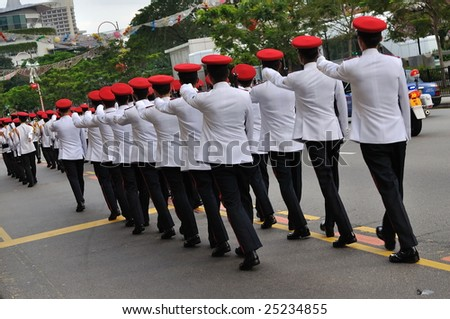 SINGAPORE - DECEMBER 07: Singapore Armed Forces contingent marching on public road during President's changing of guards parade December 07, 2008 in Singapore