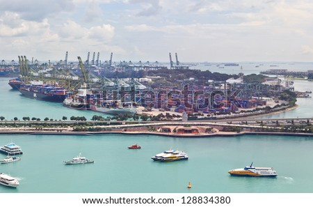 SINGAPORE - DECEMBER 28: Singapore industrial port on December 28, 2012 in Singapore. It's world's busiest port in terms of total shipping tonnage, transfers fifth of the world shipping containers.