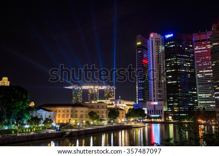 SINGAPORE-DECEMBER 14 : Singapore skyline of marina bay in Singapore at night and laser show at marina bay sands hotel on December 14, 2015