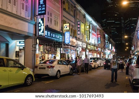 SINGAPORE - DECEMBER 20, 2017: Street packed with restaurant in Bugis area at night.