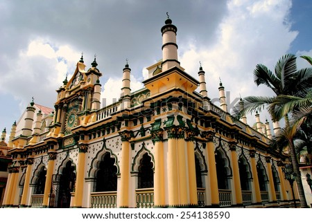 Singapore - December 18, 2007: The magnificent 1907 Masjid Abdul Gaffoor Mosque in Little India with its 22 small minarets, Moorish windows, and decorative entrance pediment - stock photo