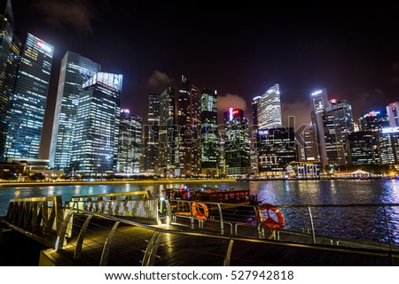 "Singapore - December 27, 2013: View of the Marina Bay area during the ""Wonder Full"", a nighttime multimedia show with lights, lasers and video projections."