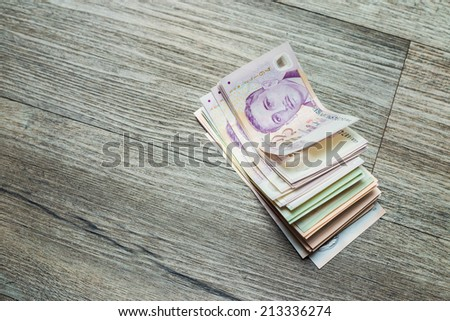 Singapore Dollars bank note on a old wooden background, close up of sgd - stock photo