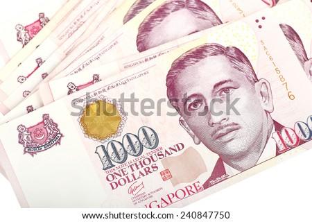 Singapore Dollars on a white background. - stock photo