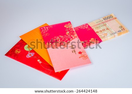 Singapore dollars with red envelopes     - stock photo