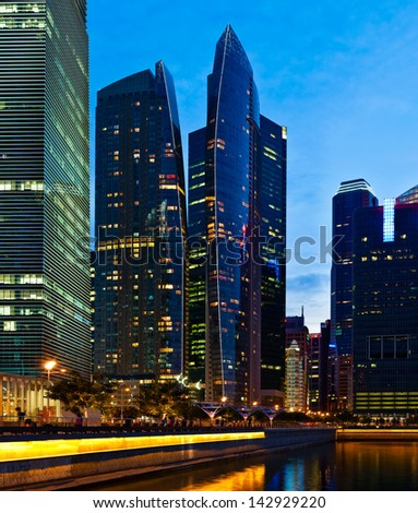 Singapore downtown business center skyscrapers  in evening - stock photo