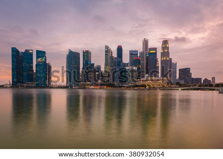 Singapore, 09 Feb 2016: Beautiful Singapore skyline with modern skyscrapers at Marina Bay during sunset.