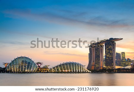 SINGAPORE-FEB 17: Marina Bay Sands hotel Singapore landmark, Sunset view of The Supertree Grove, Cloud Forest & Flower Dome at Gardens by the Bay on Feb 17, 2014 in Singapore City. - stock photo