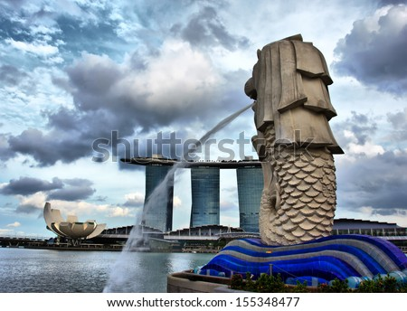 SINGAPORE - FEB 24: Merlion Statue on February 24, 2013 in Singapore. A mythical creature with the head of a lion and the body of a fish, used as a mascot and national personification of Singapore.