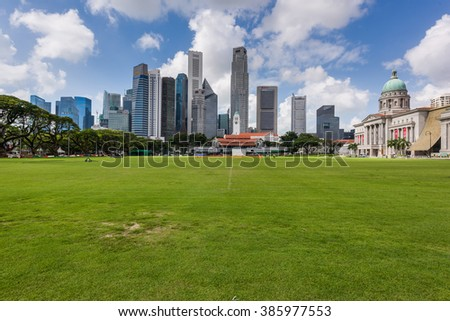 Singapore, 26 Feb 2016: Morning view of city skyline with green fields.